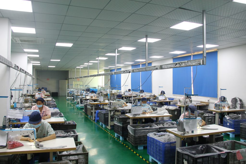 Our factory also include a sewing workshop. We have 40 sets of sewing machines and automatic needle detector.