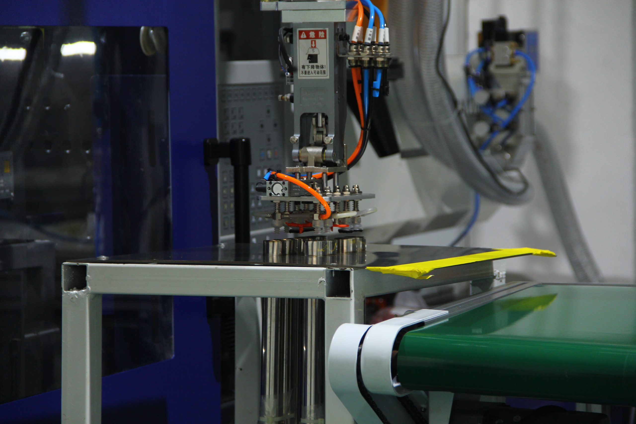 Our injection molding machines are equipped with robotic arms, this enhances our production efficiency and cost reduction.